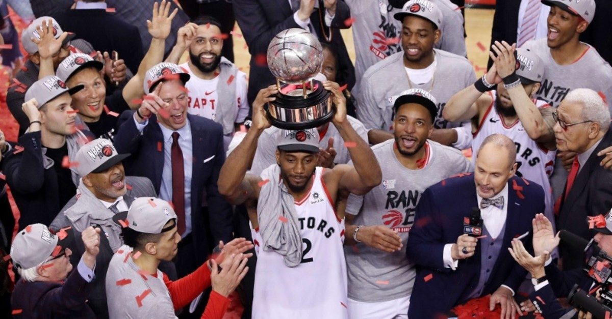 Toronto Raptors' Kawhi Leonard hoists the trophy after the Raptors defeated the Milwaukee Bucks 100-94 in Game 6 of the NBA basketball playoffs Eastern Conference finals Saturday, May 25, 2019, in Toronto. (The Canadian Press via AP)