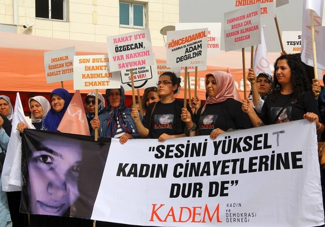 """Activists hold a banner reading """"raise your voice, stop murder of women"""" outside a courthouse where alleged killers of Özgecan Aslan, a university student whose brutal murder became a symbol of outrage against violence towards women, were being tried"""