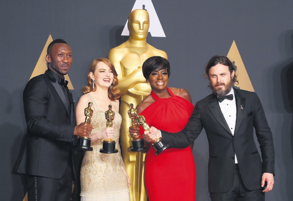 (L-R) Mahershala Ali, Emma Stone, Viola Davis and Casey Affleck pose in the press room during the 89th annual Academy Awards ceremony.