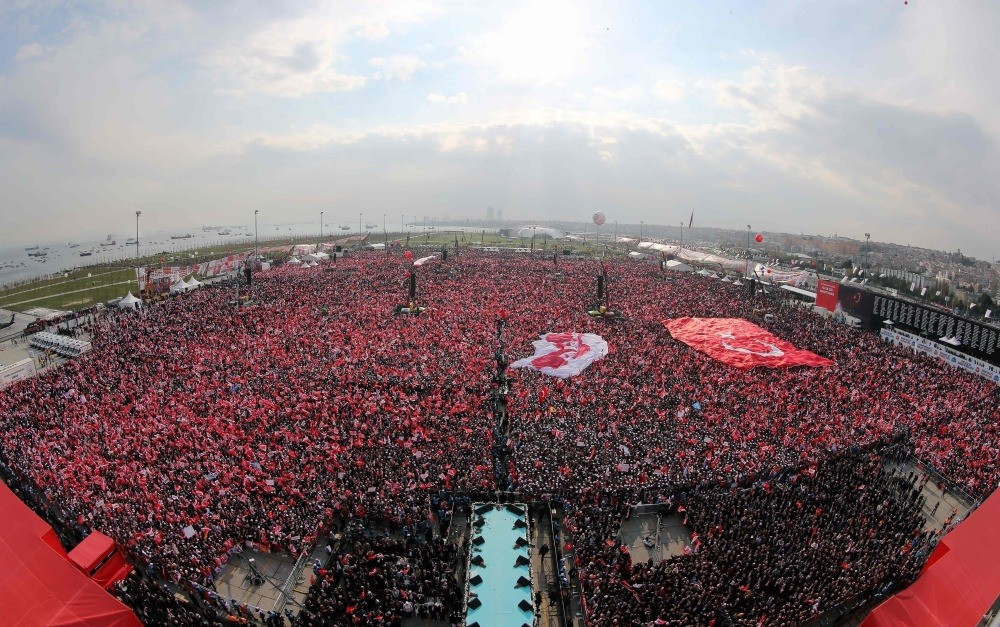 Turkish people waving the national flag and 'yes' banners as President Erdou011fan delivers a speech during a rally for the constitutional referendum at the Yenikapu0131 Square in Istanbul, April 8.