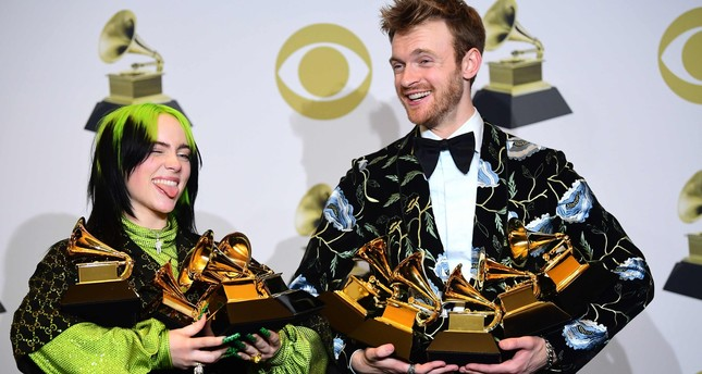 U.S. singer-songwriter Billie Eilish L and brother U.S. producer Finneas accept the award for Song Of The Year for Bad Guy during the 62nd Annual Grammy Awards on January 26, 2020, in Los Angeles. AFP Photo