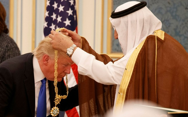 In this Saturday, May 20, 2017 file photo, Saudi King Salman presents President Donald Trump with the highest civilian honor, the Collar of Abdulaziz Al Saud, at the Royal Court Palace, in Riyadh, Saudi Arabia AP Photo