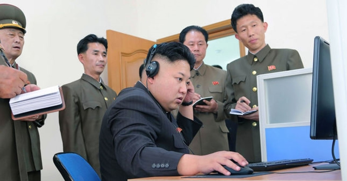 North Korean Supreme Leader Kim Jong-un uses a computer during field guidance (AFP Photo)