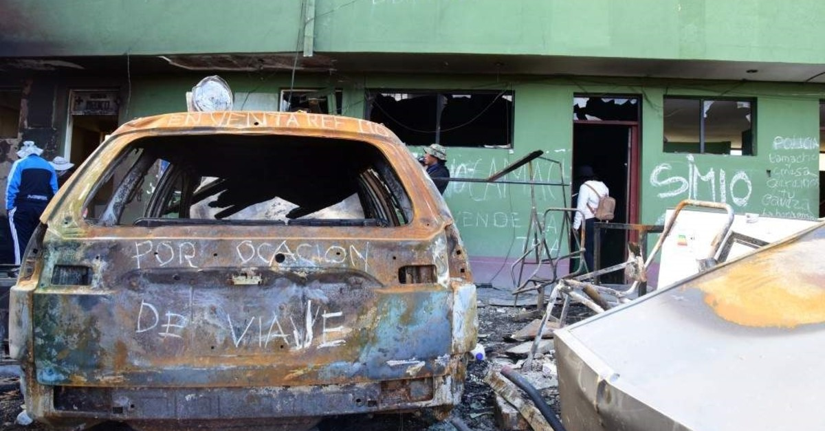 Burned vehicles are seen at a transit station after protests on Friday night, following former Bolivian President Evo Morales' exit from the country, in El Alto, Bolivia, Nov. 16, 2019. (REUTERS/Andrea Martinez)