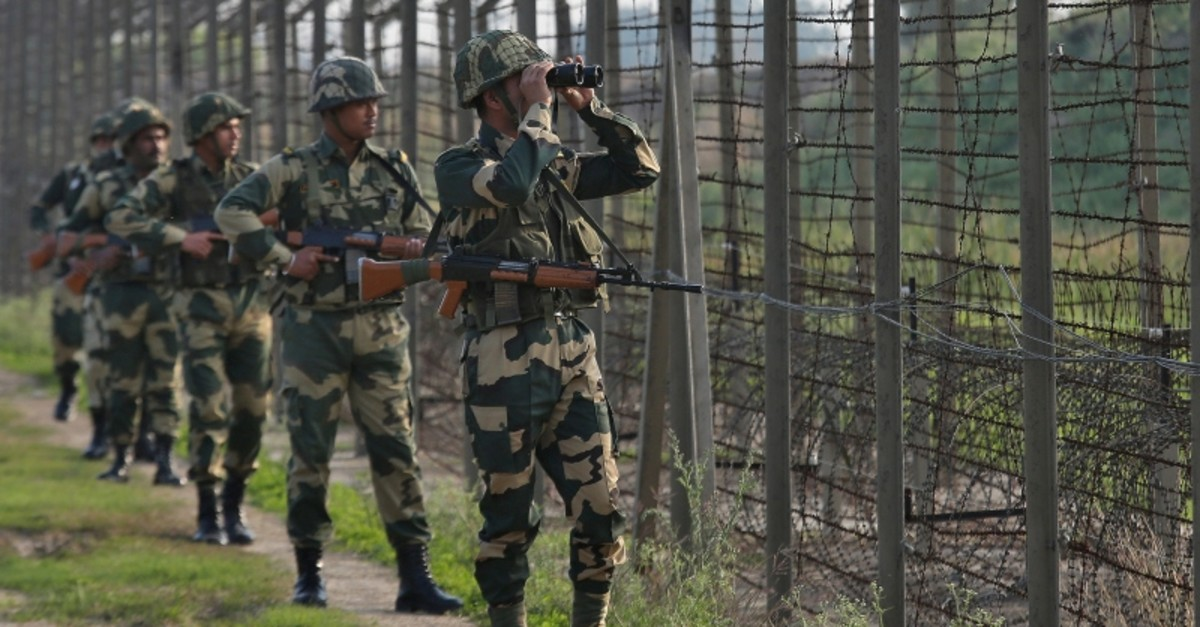 Indiau2019s Border Security Force (BSF) soldiers patrol along the fenced border with Pakistan in Ranbir Singh Pura sector near Jammu, Feb. 26, 2019. (Reuters Photo)