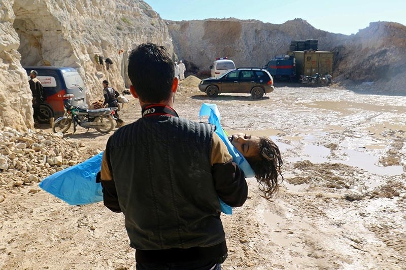 A man carries the body of a dead child, after what rescue workers described as a suspected gas attack in the town of Khan Sheikhoun in opposition-held Idlib (Reuters File Photo)