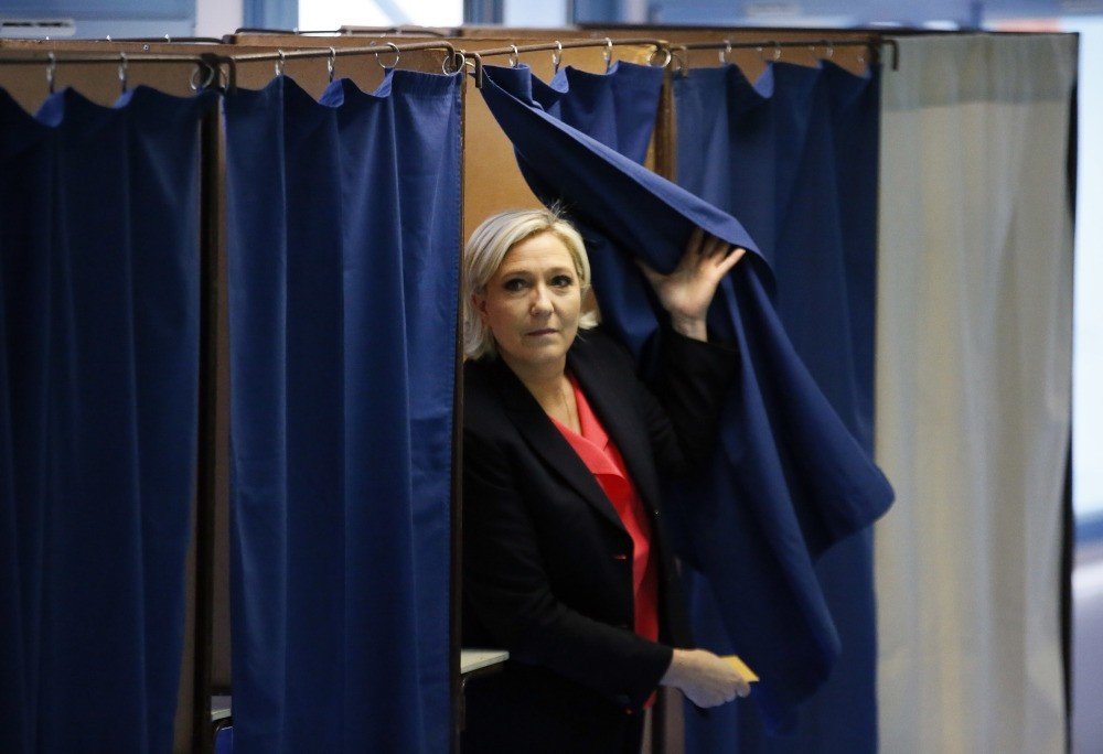 French far-right presidential candidate, Marine Le Pen exiting a voting booth before casting her ballot in Henin Beaumont, May 7.