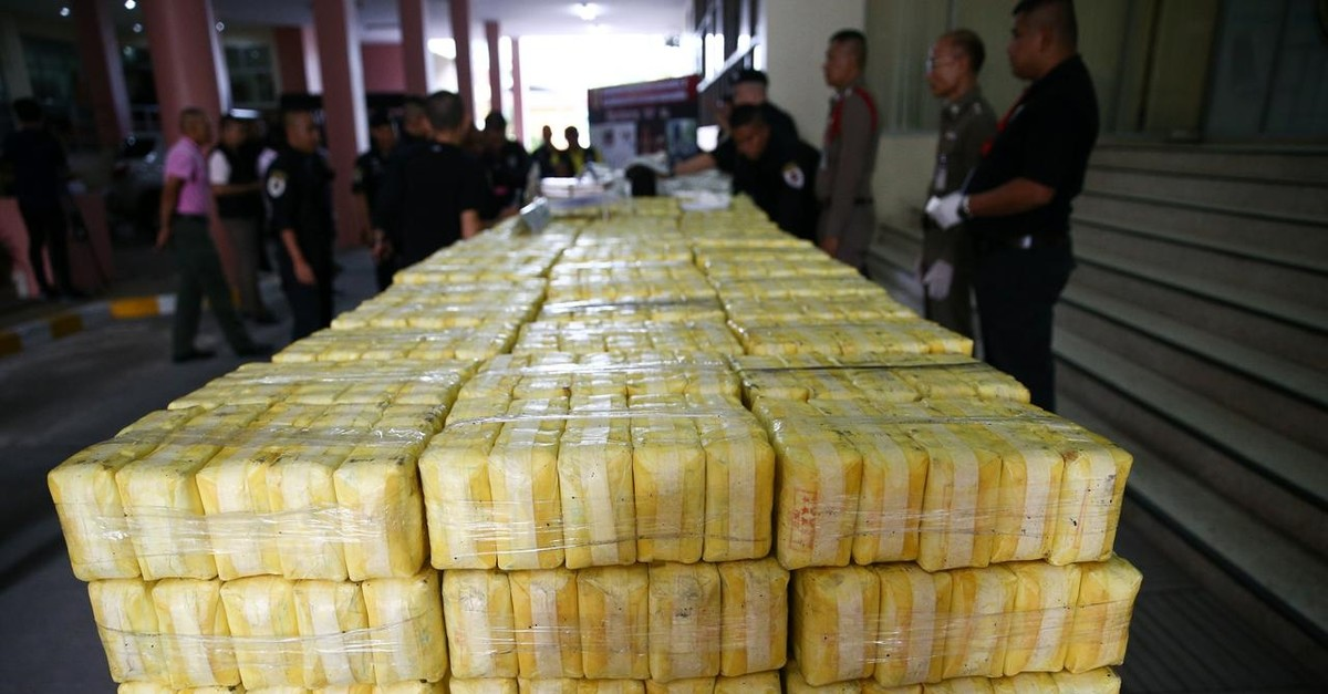Police officers arrange seized drugs before a news conference at Office of the Narcotics Control Board in Bangkok, Thailand September 18, 2018. (Reuters Photo)