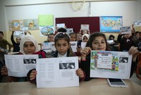 Thousands of Syrian refugee students in Turkey receive midterm report cards