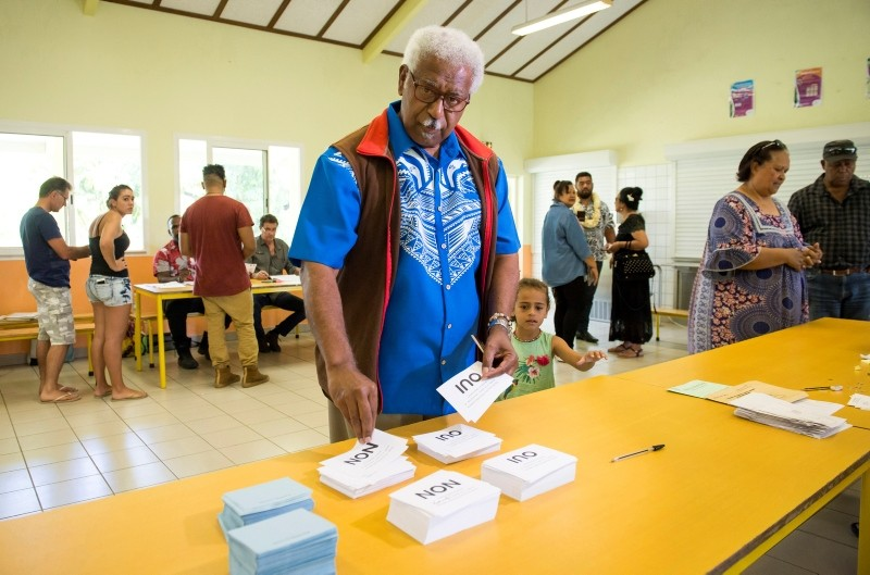 Roch Wamytan, a former leader of the independentist party, Union Caledonienne, prepares to cast his vote at a poling station in Le Mont-Dore, New Caledonia, during an independence referendum, Sunday, Nov. 4, 2018. (AP Photo)