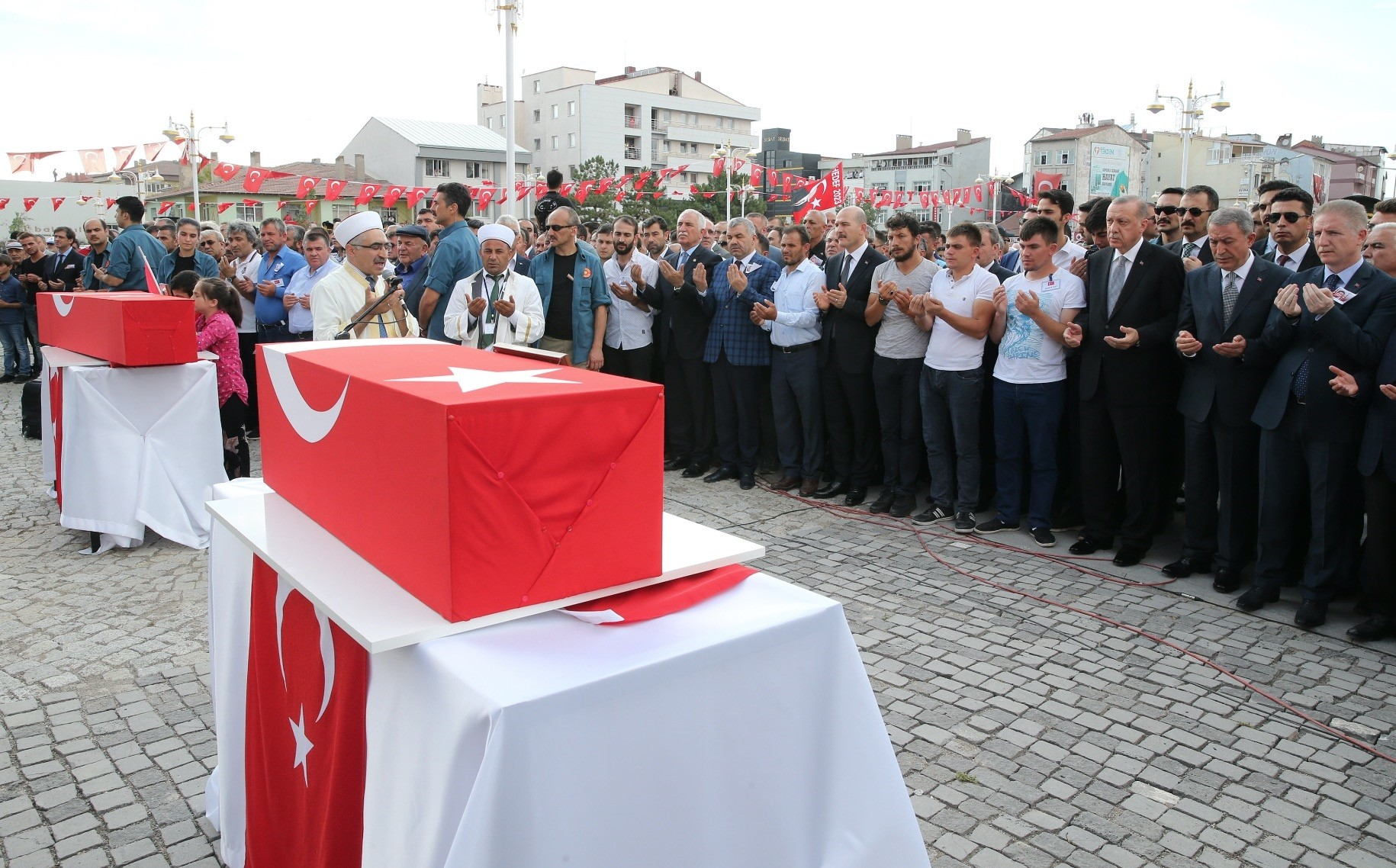 President Recep Tayyip Erdou011fan attends the funeral of Nurcan Karakaya and her 11-month-old son, Mustafa Bedirhan Karakaya, who were killed in a roadside bombing by the PKK in the southeastern province of Hakkari, July 2, 2018.