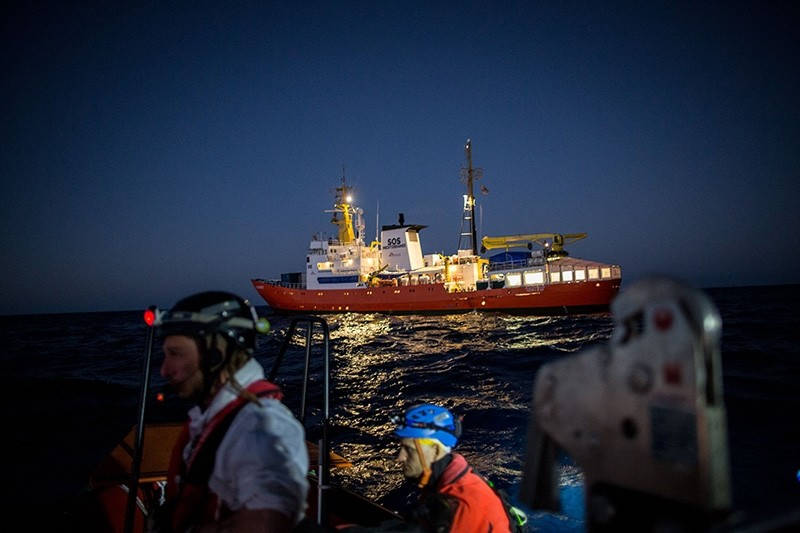 The Aquarius (C), a former North Atlantic fisheries protection ship now used by humanitarians SOS Mediterranee and Medecins Sans Frontieres, is seen on Dec. 26, 2017, during a rescuing operation in the Mediterranean Sea. (AFP Photo)