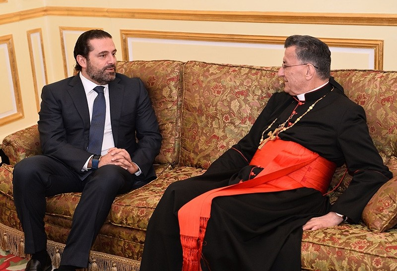 This handout picture released by the press office of Lebanon's Maronite Patriarchate shows Lebanon's resigned prime minister Saad Hariri meeting with Lebanon's Christian Maronite patriarch Bechara al-Rahi on November 14, 2017 (AFP Photo)
