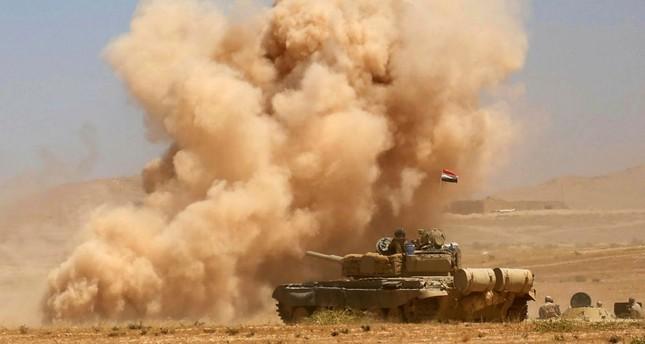 Smoke billows as Iraqi government forces advance toward the city of Tal Afar, Aug. 20.