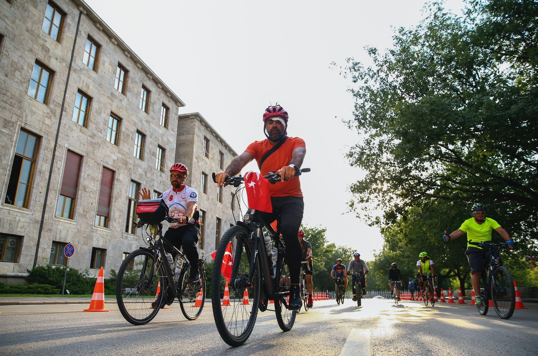 Cyclists ride to the entrance of Turkish parliament where they handed a Turkish flag to the parliamentary speaker to conclude their ride from Germany.