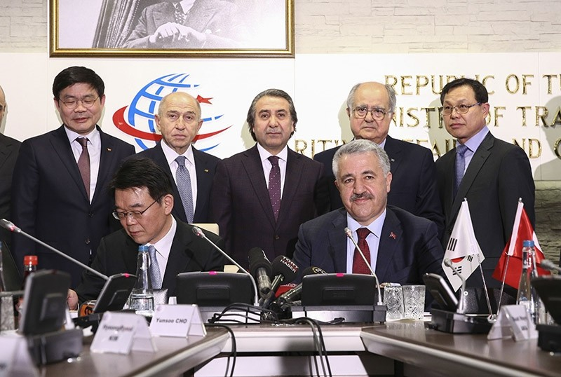 Transport, Maritime and Communications Minister Ahmet Arslan sits (R) next to his South Korean counterpart in the premises of his ministry in Ankara. March 16, 2017. (AA Photo)