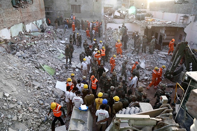 Indian Army, NDRF and SDRF personnel carry out rescue work after a building collapsed due to a gas cylinder blast during wedding party in Beawar, in the Indian state of Rajasthan (AFP Photo)