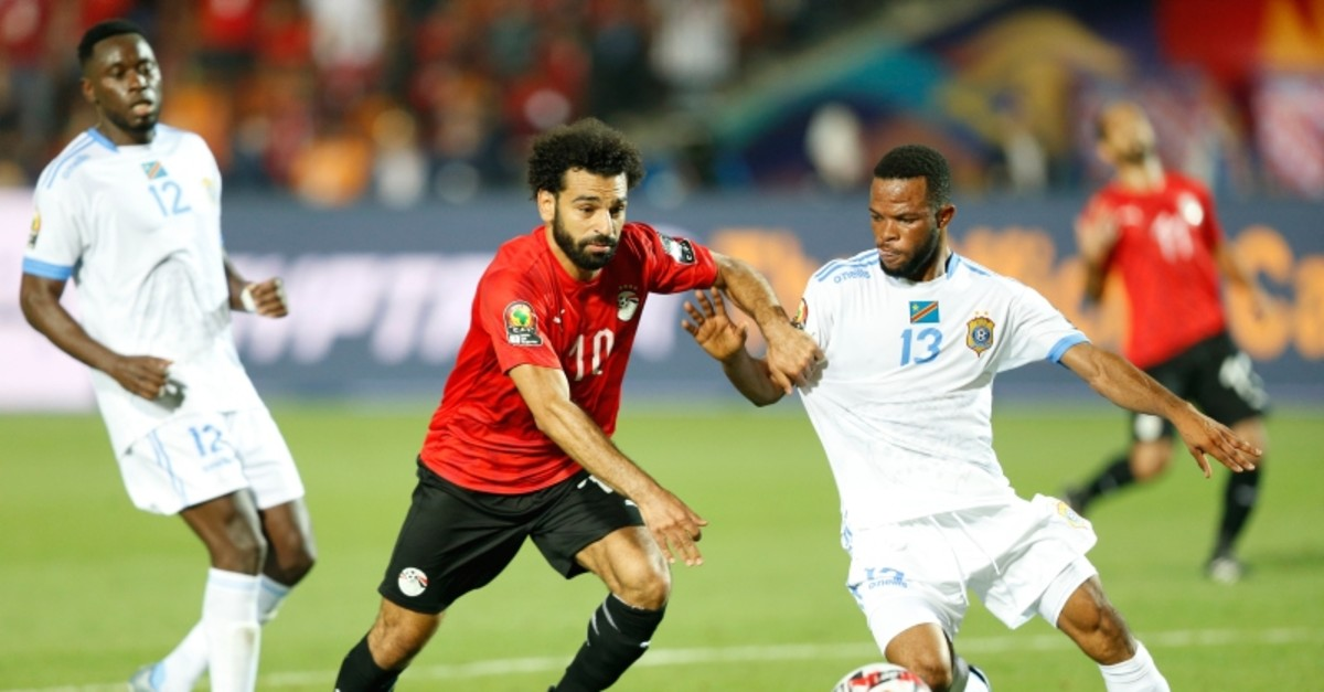 Egypt's Mohamed Salah, left, and DR Congo's Meschack Elia Lina fight for the ball during the group A soccer match between Egypt and DR Congo at the Africa Cup of Nations at Cairo International Stadium in Cairo, Egypt, June 26, 2019. (AP Photo)