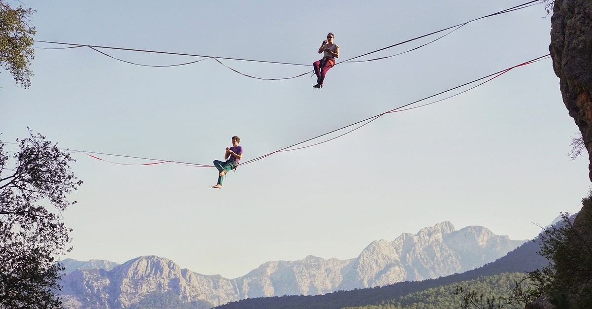 Slacklining is similar to the art of walking a tightrope.