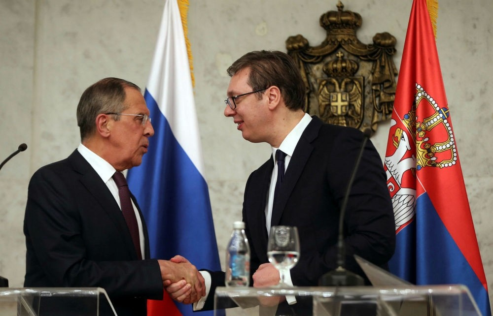 Russian Foreign Minister Sergei Lavrov (L) shakes hands with Serbian President Aleksandar Vucic (R), Belgrade, Feb. 21.