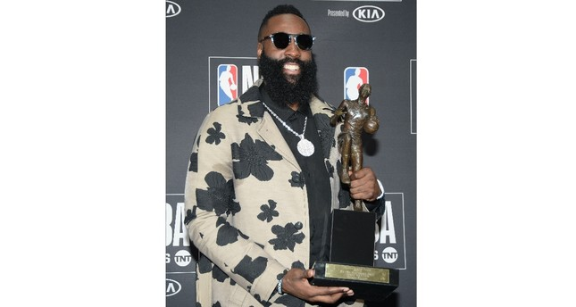 Houston Rockets guard James Harden poses for photos with his MVP award during the NBA Award Show at Barker Hanger, June 25.