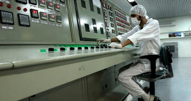 In this Feb. 3, 2007 file photo, an Iranian technician works at the Uranium Conversion Facility just outside the city of Isfahan, Iran, 255 miles 410 kilometers south of the capital Tehran. AP Photo