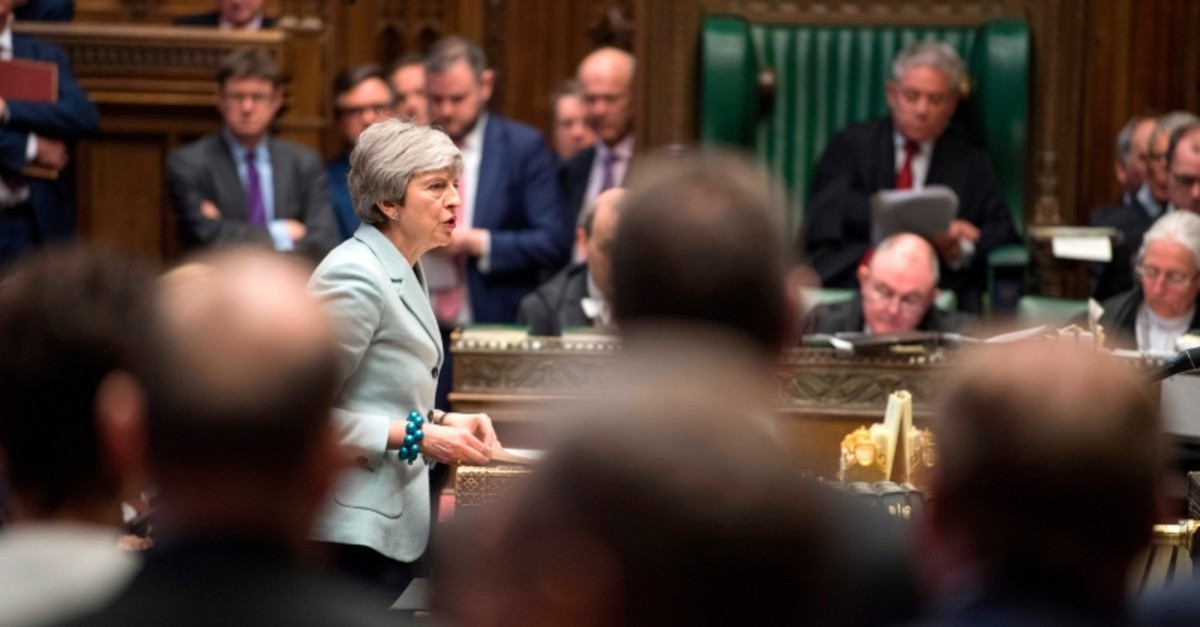 A handout photograph released by the UK Parliament shows Britain's Prime Minister Theresa May making a statement in the House of Commons in London on March 25, 2019 outlining the next steps that parliament will take in the Brexit process. (AFP Photo)