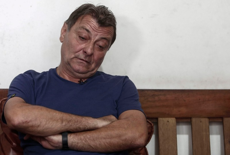In this file photo taken on October 20, 2017 Italian ultra-leftist militant Cesare Battisti gestures during an interview with AFP in Cananeia, Sao Paulo state, Brazil. (AFP Photo)