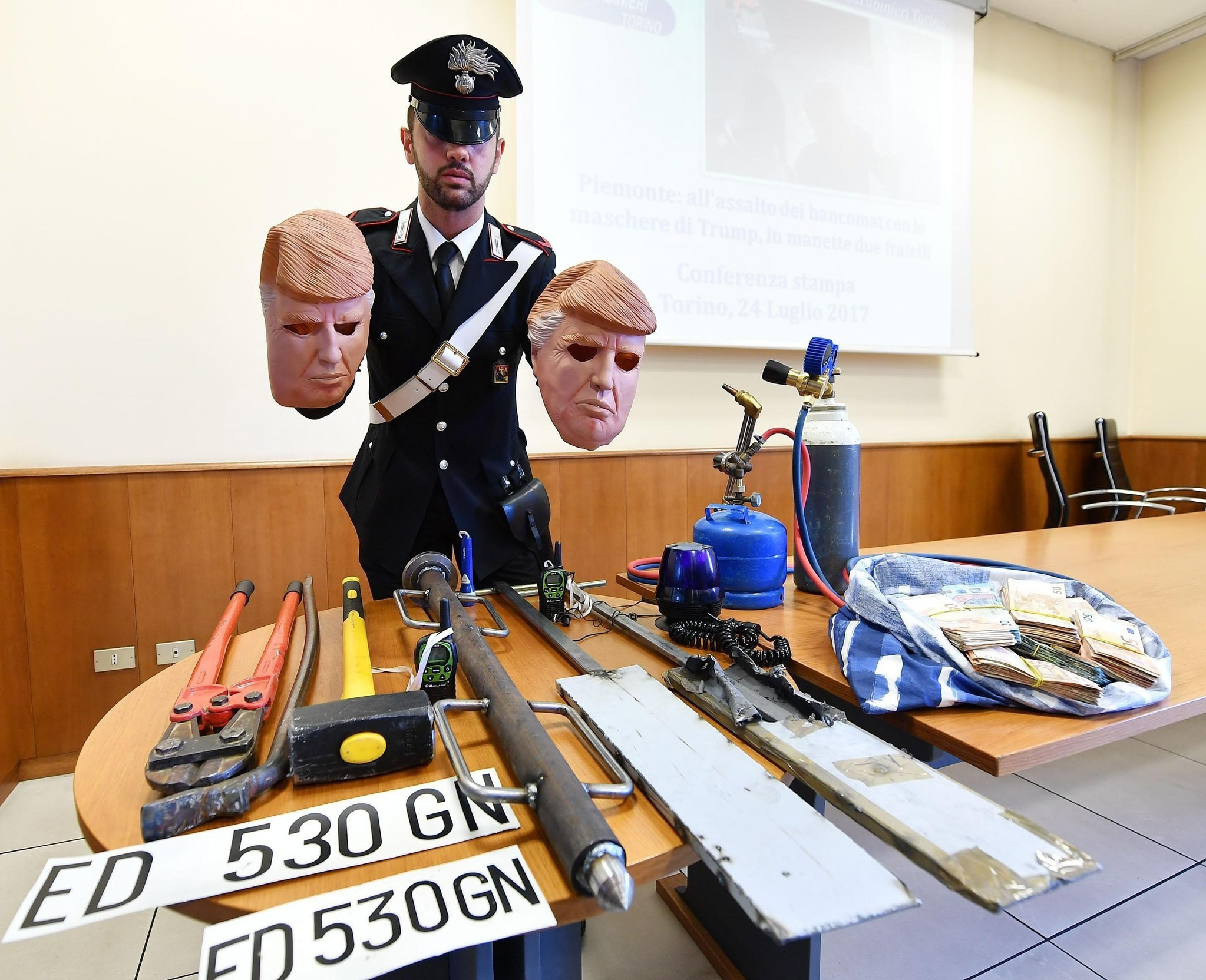 Masks of US President Donald J. Trump used by two alleged thieves are displayed by Italian Carabinieri police during a press conference in Turin, northern Italy, 24 July 2017. (EPA Photo)