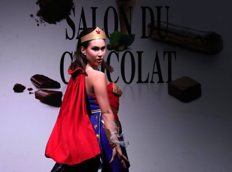 A model dressed in an outfit made with chocolate presents a creation at the