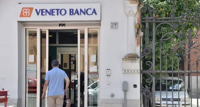 A man enters a branch of Italian bank Veneto Banca in Rome, Italy.
