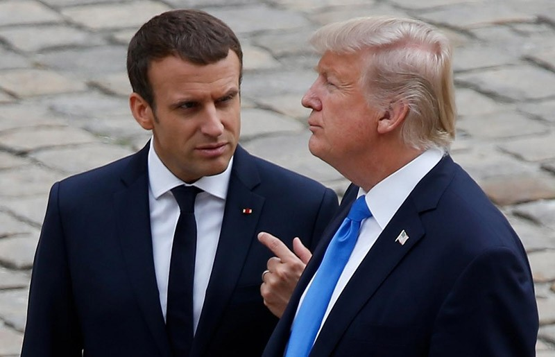 French President Emmanuel Macron and U.S. President Donald Trump walk in the courtyard as they leave after a welcoming ceremony at the Invalides in Paris, France, July 13, 2017. (Reuters Photo)