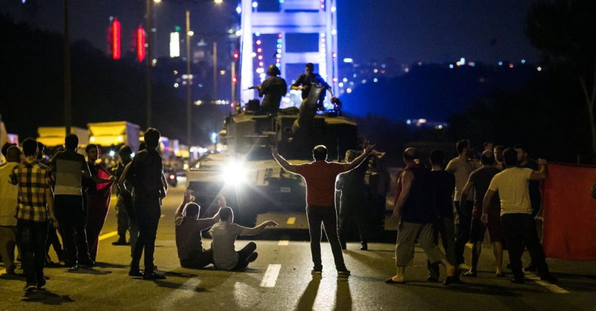 People take over a tank near the Fatih Sultan Mehmet Bridge during resistance against the deadly FETu00d6-led coup attempt on the night of July 15, Istanbul.