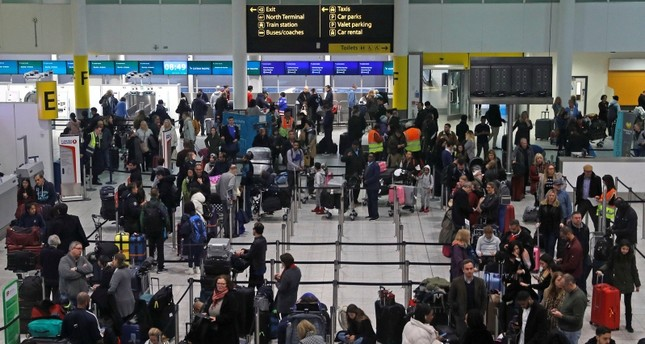Passengers wait around in the South Terminal building at Gatwick Airport after drones flying illegally over the airfield forced the closure of the airport, in Gatwick, Britain, December 20, 2018. (REUTERS Photo)