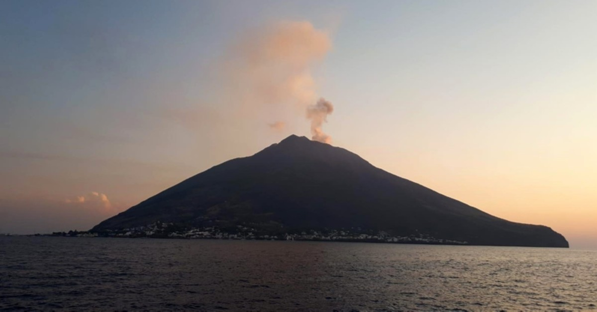 A column of dense smoke rises from the crater of Stromboli volcano, where a powerful explosion occurred with sand, ash and other volcanic material falling on the surrounding area, Stromboli, Messina, Italy, 28 August 2019. (EPA Photo)