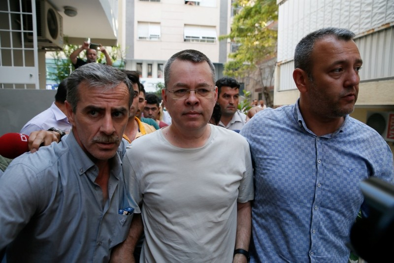 Pastor Andrew Brunson (C) is escorted by police officers while he is being transferred to his home where he will remain in house arrest, on July 25, 2018, in Izmir, western Turkey. (AA Photo)