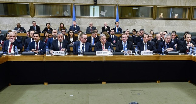 Turkish Cypriot President Akıncı, third from left, UN Secretary-General Guterres, center, and Greek Cypriot leader Anastasiades, fourth from right, attend the Cyprus peace talks (AP Photo)