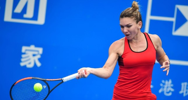 Simona Halep of Romania hits a return against Nicole Gibbs of the US in the first round of the Shenzhen Open tennis tournament in Shenzhen, Jan. 1.