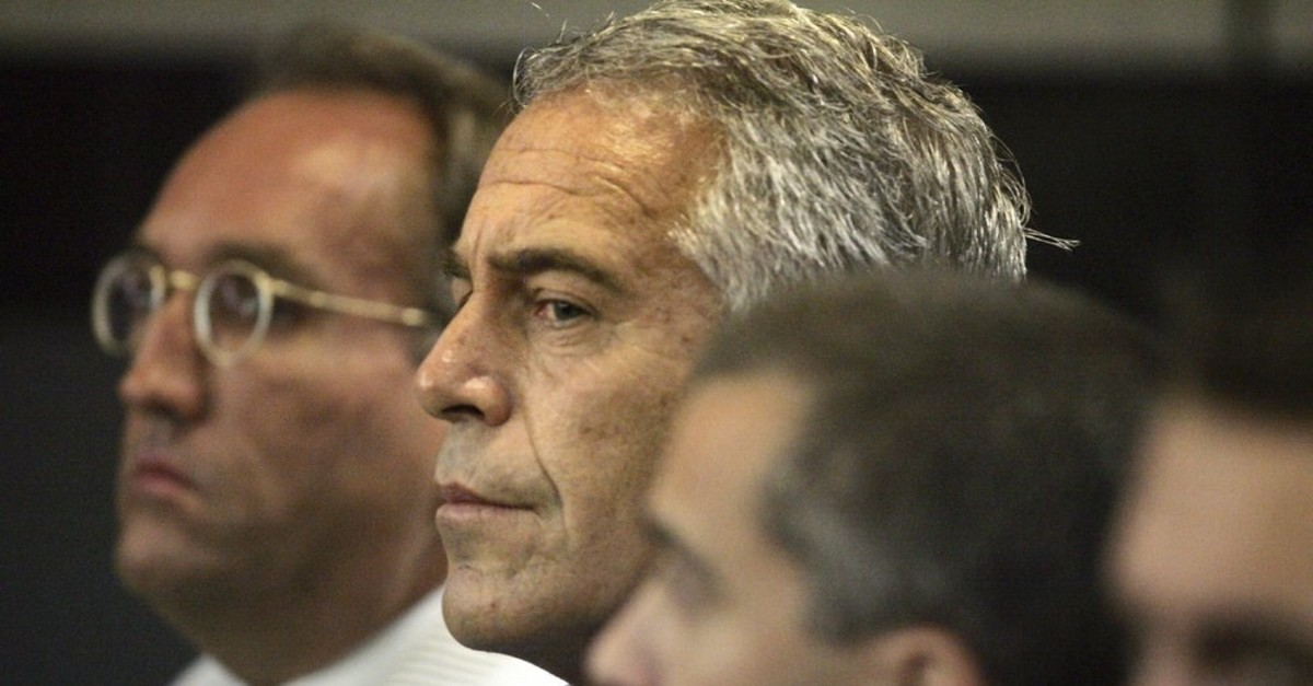 In this July 30, 2008, file photo, Jeffrey Epstein, center, appears in court in West Palm Beach, Fla. (AP Photo)