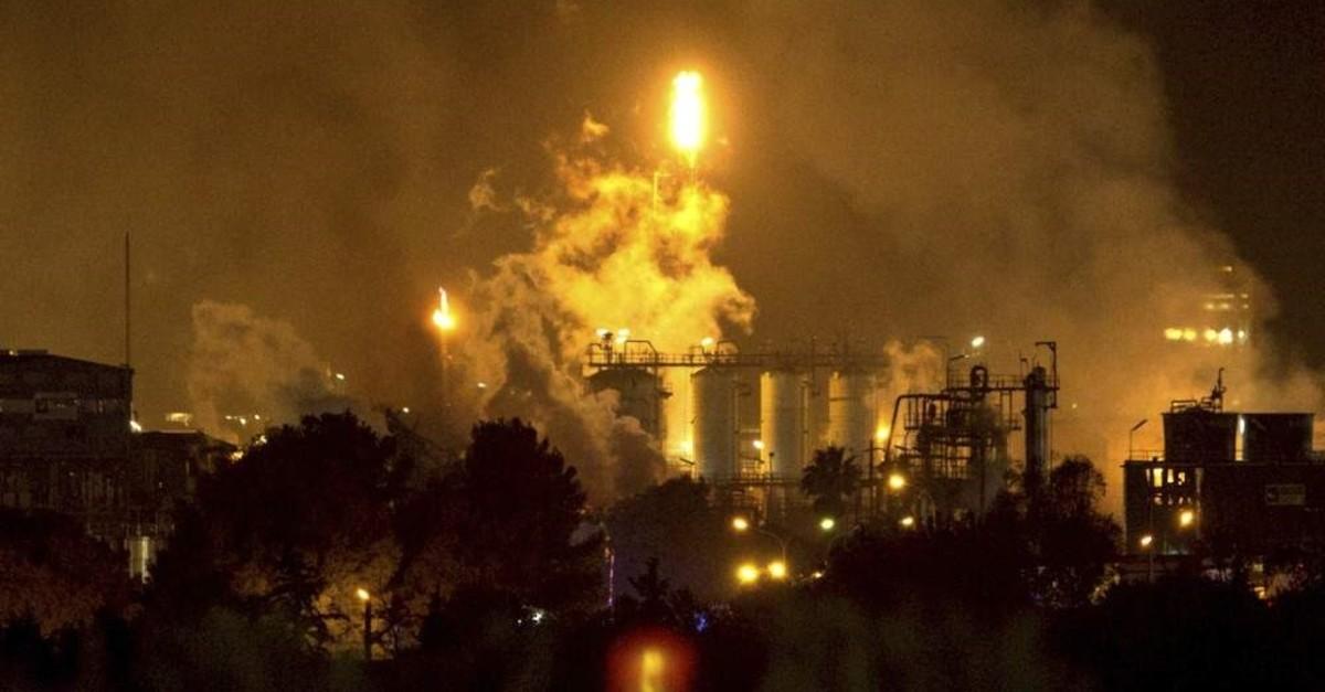Smoke rise following a big explosion at an industrial hub near the port city of Tarragona, Spain, Tuesday, Jan. 14, 2020. (AP Photo)