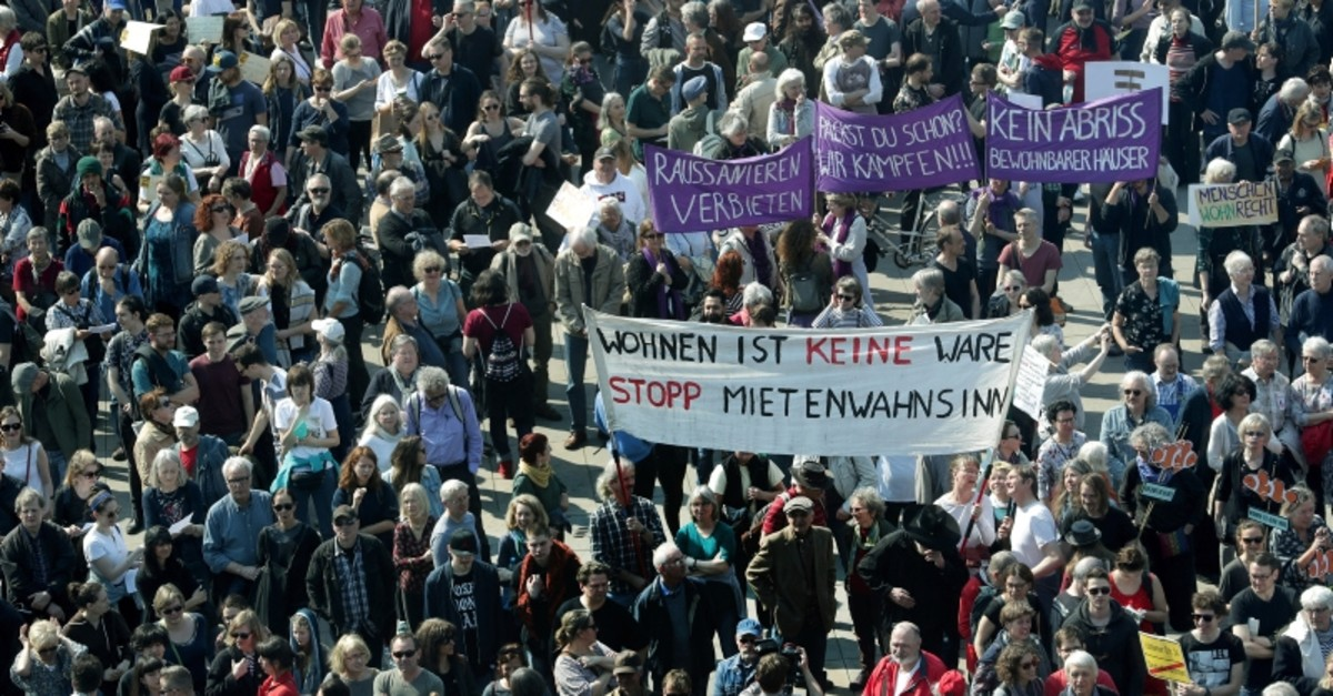 Protesters attend a demonstration against rent increase in Berlin, Germany, Saturday, April 6, 2019 (AP Photo)