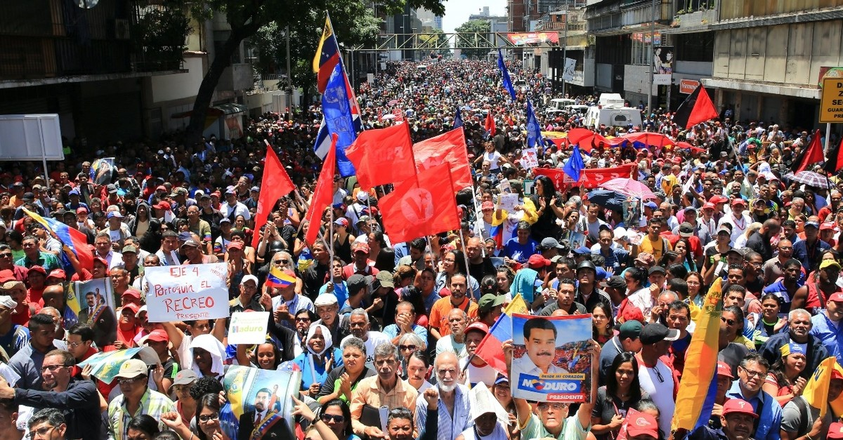 Supporters of Venezuelau2019s President Nicolas Maduro take part in a rally in support of his government in Caracas, April 30, 2019.