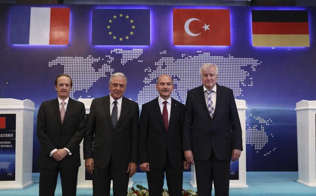 From L to R, Charles Fries, France's envoy to Turkey, EU Commissioner for Migration Dimitris Avramopoulos, Interior Min. Süleyman Soylu and German Interior Min. Horst Seehofer pose for photos following their news conference Ankara, Oct. 3, 2019.