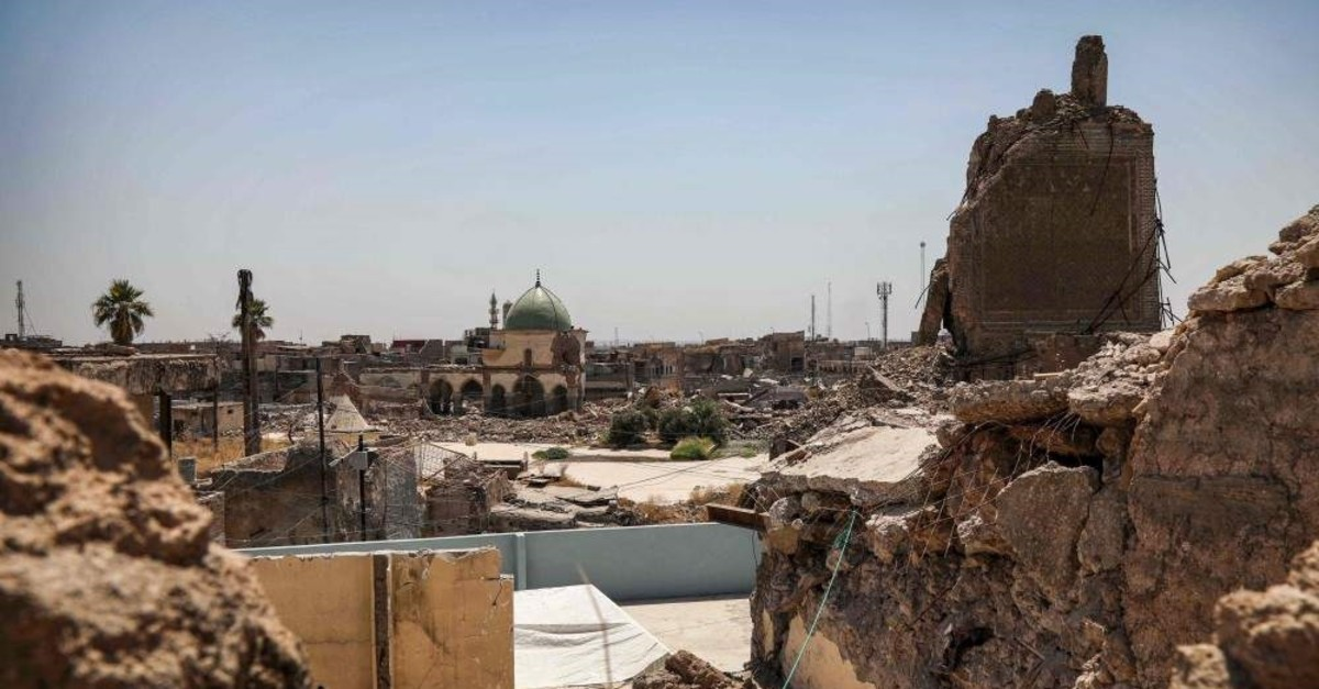 A view of the damaged site of the Great Mosque of al-Nuri in Iraq's war-ravaged Old City of Mosul and the base of the destroyed Al-Hadba leaning minaret, Aug.10, 2019. (AFP PHOTO)