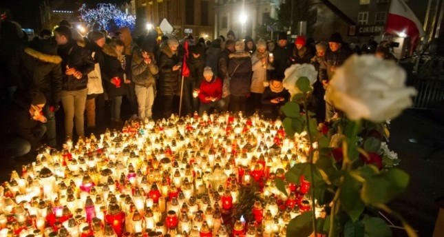 People place candles as they mourn the mayor of Gdansk, Pawel Adamowicz, Gdansk, Poland, Jan. 14.