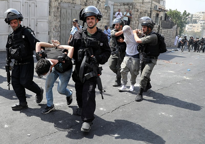 Israeli security forces arrest Palestinian men following clashes outside Jerusalem's Old city, July 21, 2017. (Reuters Photo)