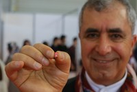 Turkish man makes tiny book weighing 0.2 grams