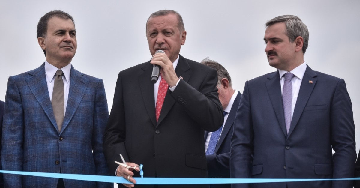President Recep Tayyip Erdou011fan (C) speaks at a collective opening ceremony in Istanbul, June 19, 2019.