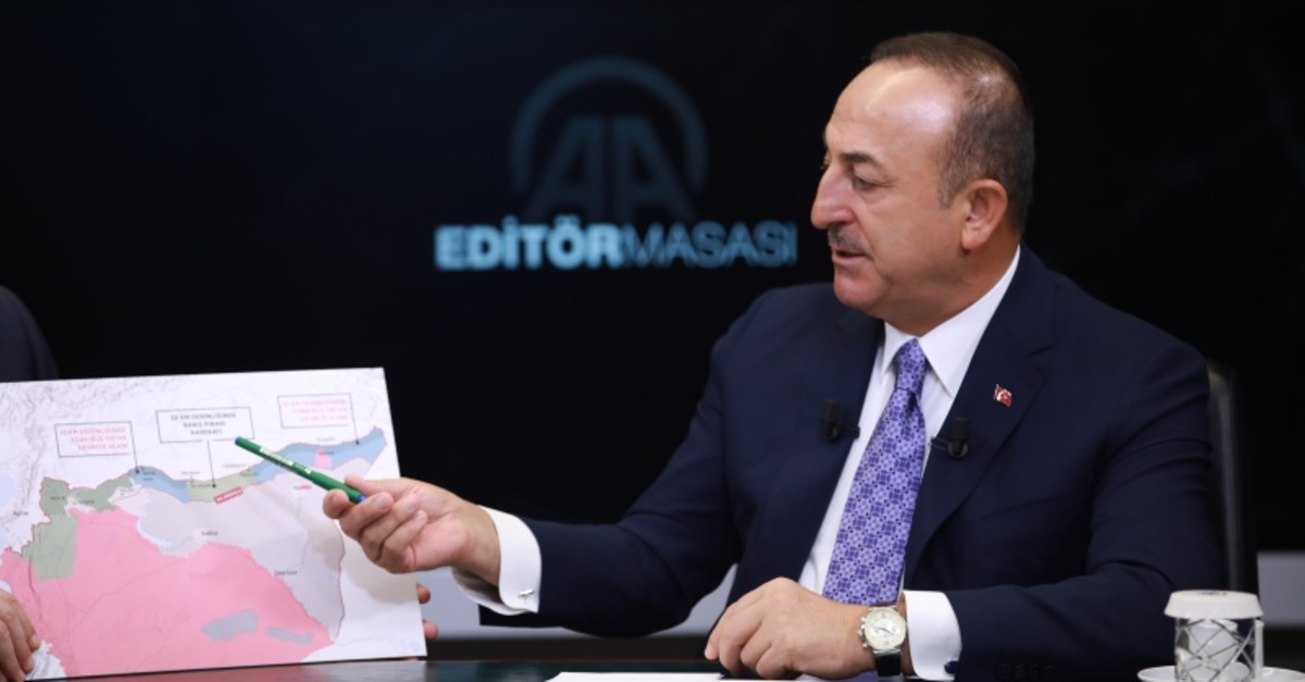 Foreign Minister Mevlu00fct u00c7avuu015fou011flu speaks at the Anadolu Agency's Editor's Desk on Wed. Oct. 23, 2019 (AA Photo)