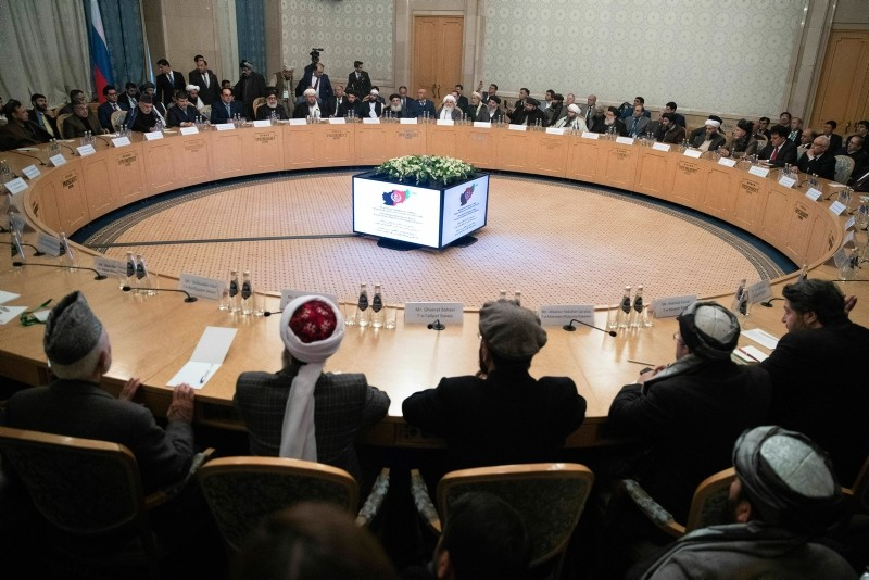 Afghan politicians attend the ,intra-Afghan, talks at the President Hotel in central Moscow (AP Photo)